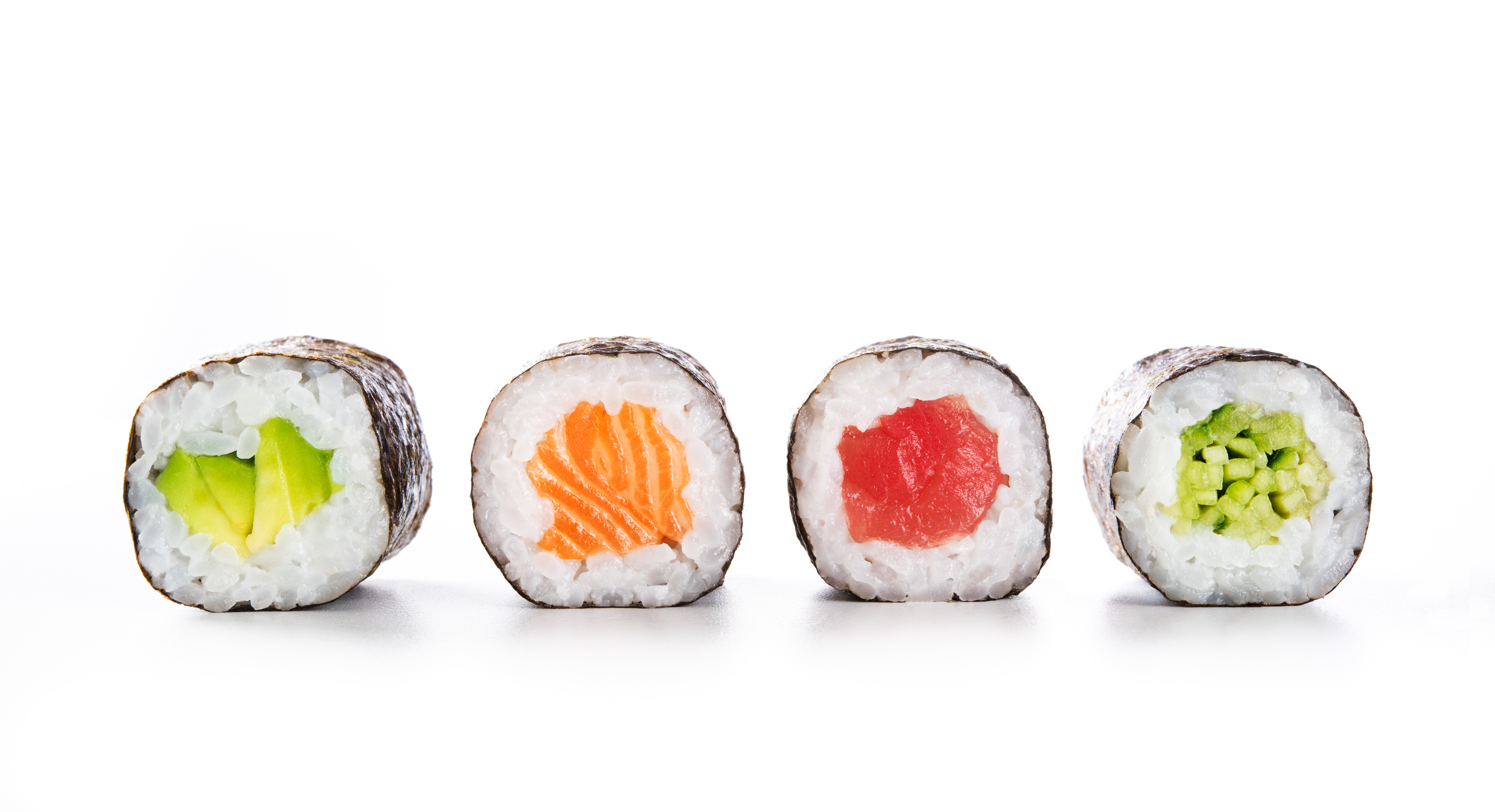 Four maki rolls in a row with salmon, avocado, tuna and cucumber isolated on white background. Fresh hosomaki pieces with rice and nori. Closeup of delicious japanese food with sushi roll.